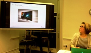 Charlotte presenting on PR - slides says 'trust'