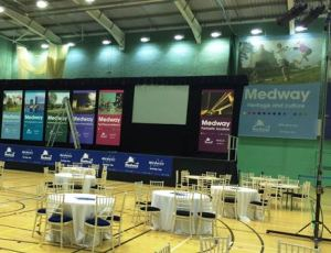 The election count room at MEdway showing lare banners with the brand name 'Medway'